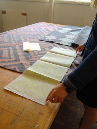Laura maps out her weaving pattern on paper