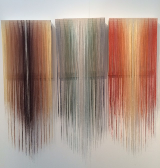 "Nike Shroder, ""Fragments 4 (Walnut)"", ""Fragments 5 (Sage)"" and ""Fragments 6 (Maple)"", 2013, rayon threads on canvas.  Courtesy of Walter Maciel Gallery."