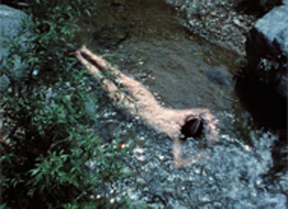 "Ana Mendieta still from ""Creek"" 1974, super 8 film, color, silent. Courtesy BAMPFA."
